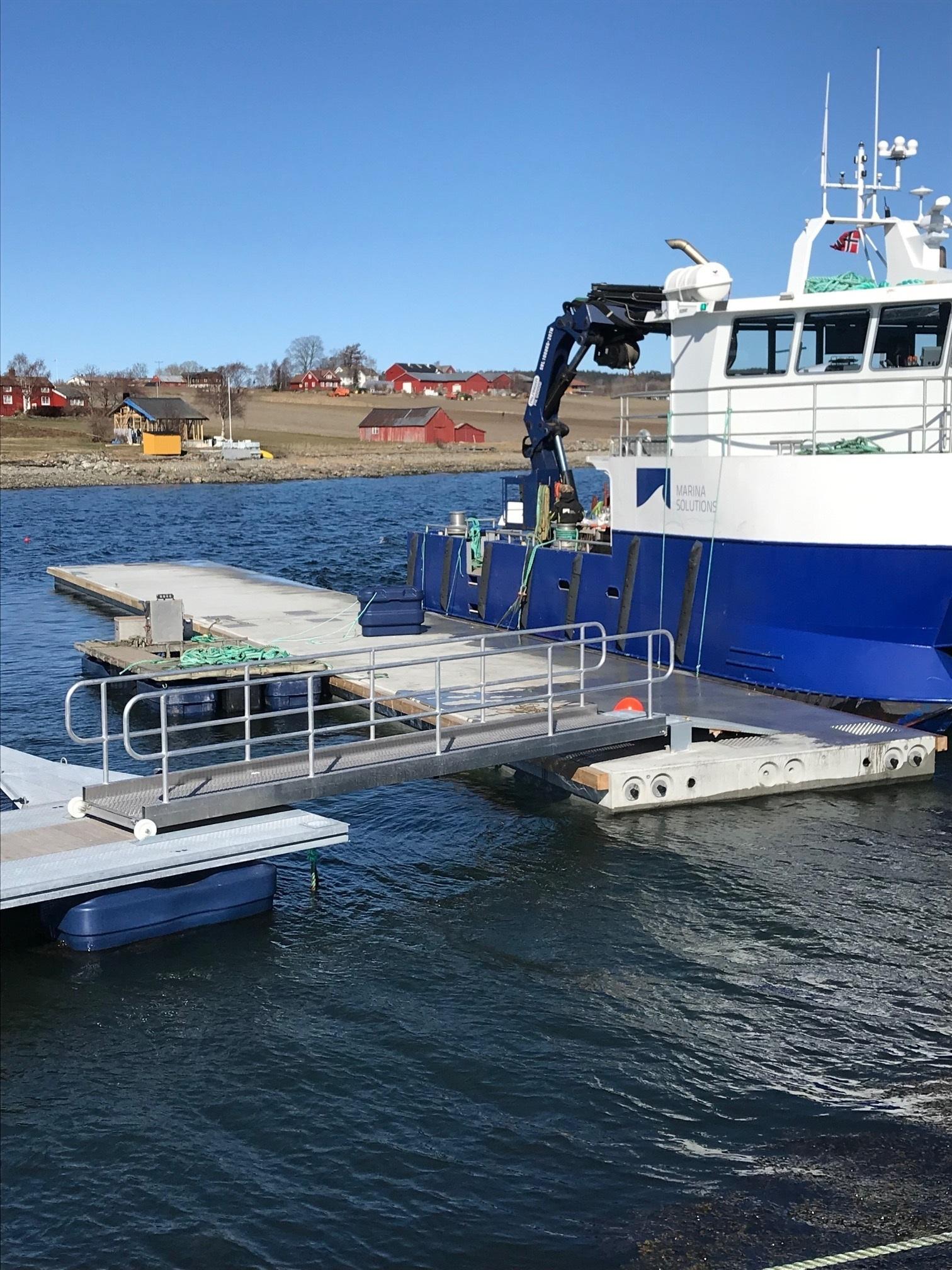 https://www.marinasolutions.no/uploads/Mostadkaia-Frosta-Marina-Solutions-bølgedemper-Marina-Ocean-Aursand.jpg